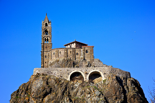 Saint-Michel d'Aiguilhe is a chapel in Aiguilhe, near Le Puy-en-Velay, France, built in 962 on a volcanic formation 85 metres (279 ft) high. The chapel is reached by 268 steps carved into the rock. It was built to celebrate the return from the pilgrimage of Saint James. In 1429, the mother of Joan of Arc, Isabelle Romée, was said to have come to the site to pray.